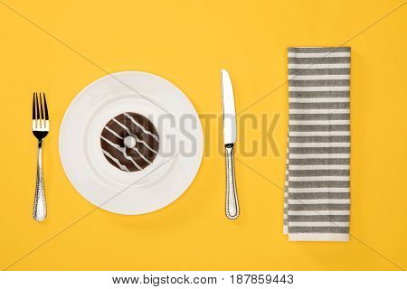 Overhead View Of Donut With Sweet Glaze In Plate And Napkin Isolated On Yellow. Donuts Chocolate Bac