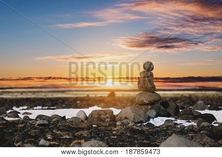 Balance stones, Zen stone stacked, with blurred sunset background