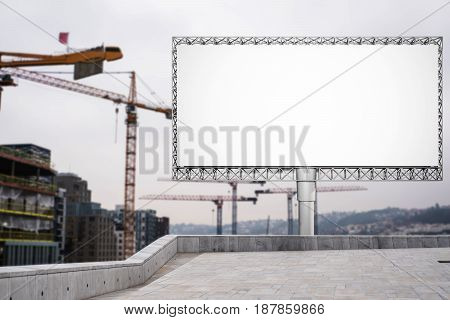 Blank billboard for advertisement at in the city with construction crane