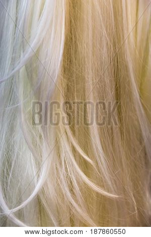 Strands of gray and light blonde hair or wig.