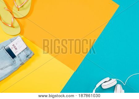 Summer Vacation Background With Headphones, Flip Flops, Denim Trousers, Ticket, Passport With Copy S