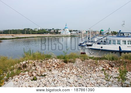 Landscape with a river and boats at the pier of the embankment of Cheboksary. Russia, Volga, summer