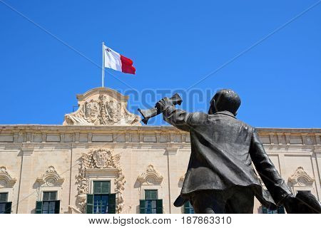 View of the Auberge de Castille in Castille Square with a statue of Manuel Dimech in the foreground Valletta Malta Europe.