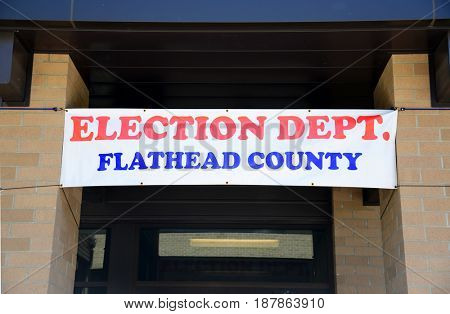 KALISPELL, MONTANA, USA - May 23, 2017: Banner hangs above the doorway of the Flathead County Election Department to advertise the department'??s location during election season.