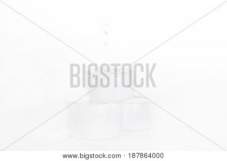 Water Drops Falling On Heap Of Boxes Isolated On White