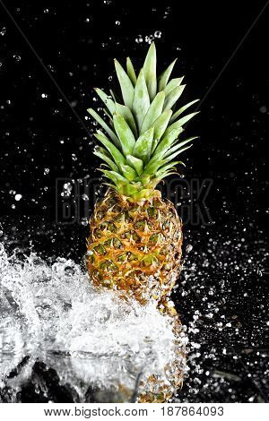 Close-up View Of Fresh Ripe Pineapple With Water Drops Isolated On Black