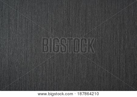Black abstract metallic background pattern of brushed metal texture