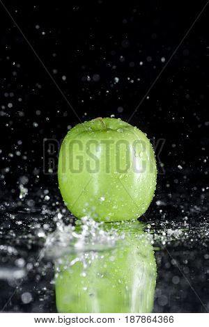 Green Apple In Water With Reflection Isolated On Black With Copy Space, Fresh Fruits Background Conc