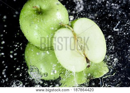 Green Apples In Water With Reflection On Black, Fresh Fruits Concept