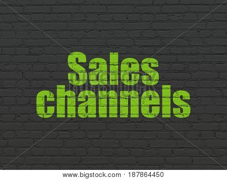 Advertising concept: Painted green text Sales Channels on Black Brick wall background