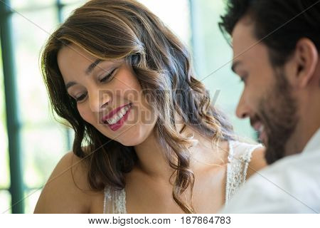 Smiling young woman dating with man in restaurant