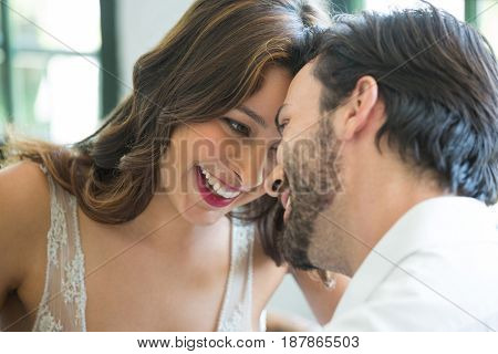 Close-up of romantic young couple spending leisure time in restaurant