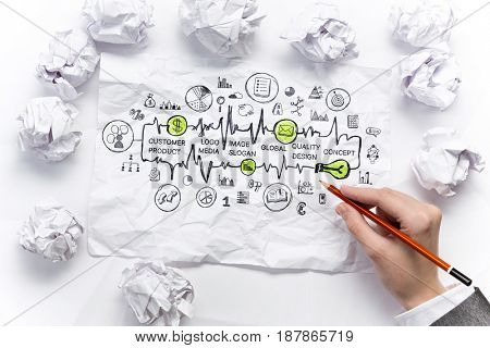 Woman sketching ideas on paper sheet