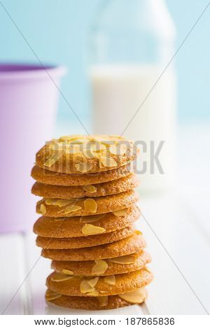 Sweet almond cookies on white wooden table.