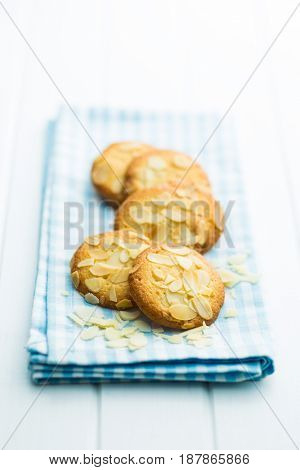 Sweet almond cookies on checkered napkin.