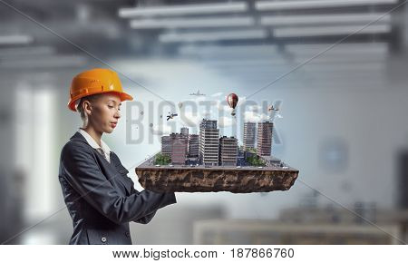 Woman presenting construction model