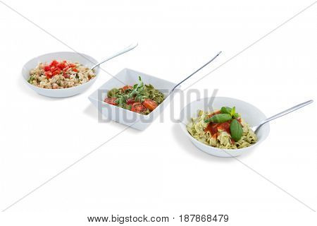 Pasta served in bowls against white background