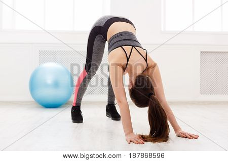 Yoga stretching. Woman in dog pose. Young slim girl makes exercise
