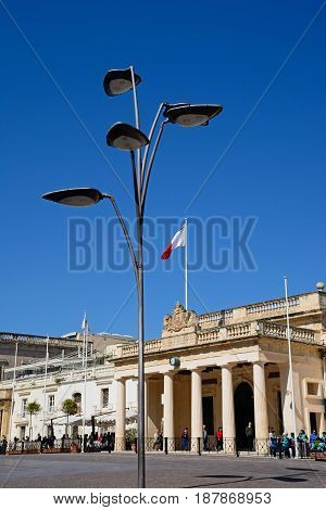 VALLETTA, MALTA - MARCH 30, 2017 - View of the main guard building in St Georges Square with a modern streetlight in the foreground Valletta Malta Europe, March 30, 2017.