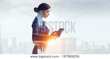 Attractive business lady working on tablet