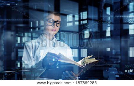 Cute girl intern read book. Mixed media