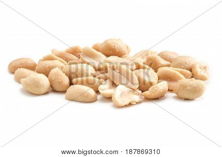 Close-up view roasted salted peanuts isolated on white background arranged peeled peanuts