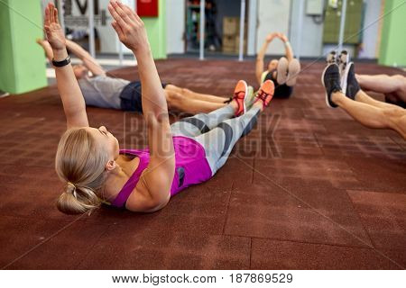 fitness, sport, training and lifestyle concept - group of people exercising in gym