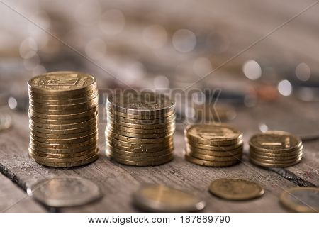 Stacks Of Coins On Wooden Tabletop, Coins Stacked Concept