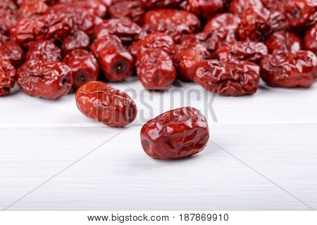 Dried jujube fruits red dates on white
