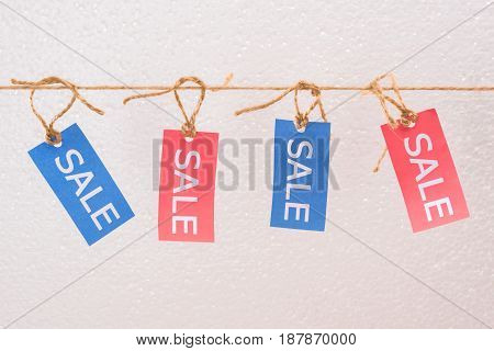 Colorful Sale Tags Hanging On Rope, Offer Sale Tags