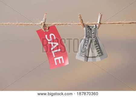 Sale Sign And One Hundred Us Dollar Banknote On Clothesline, Offer Sale Concept