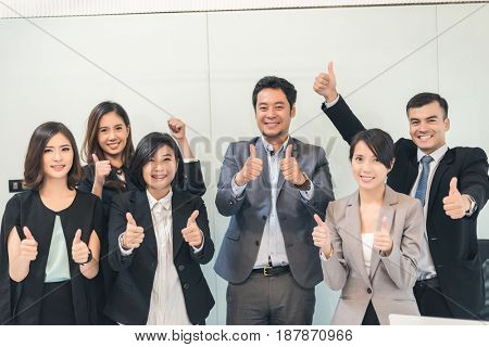 cheerful business people give you an excellent gesture
