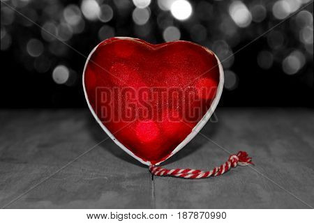 beautiful figurine red heart on black and white background