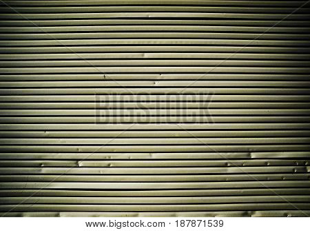 Plastic siding closeup, wall texture, abstract, grunge background, house siding background, detail of a house wall, beige siding, old siding