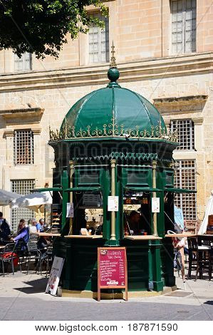 VALLETTA, MALTA - MARCH 30, 2017 - Pavement cafe in a small square along Republic Street aka Triq Ir Repubblika Valletta Malta Europe, March 30, 2017.