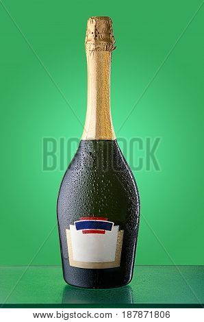 Corked cold bottle of sparkling wine with condensation and reflection. Empty label logos removed.