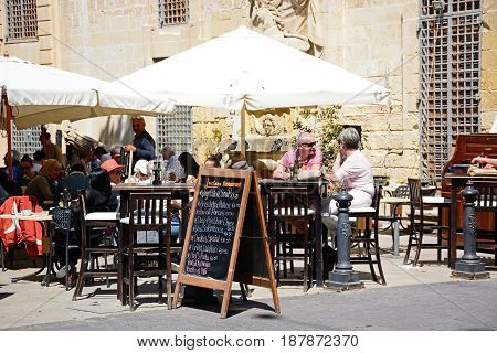 VALLETTA, MALTA - MARCH 30, 2017 - Pavement cafes in a small square along Republic Street aka Triq Ir Repubblika Valletta Malta Europe, March 30, 2017.