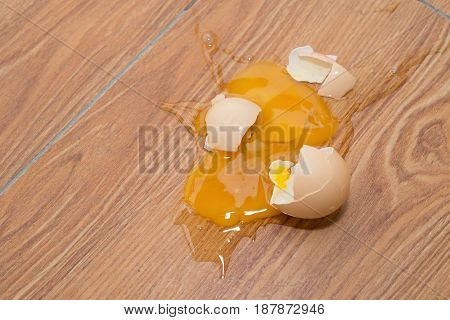 a broken egg on floor horizontal composition