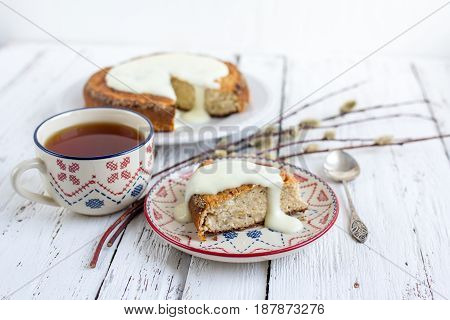 Banana Cake With Cottage Cheese In A Creamy Sauce With A Cup Of