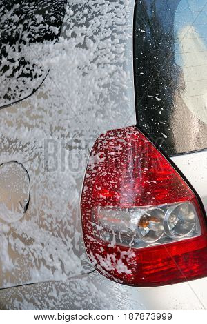 washing a car with soapy water vertical