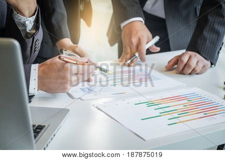 Teamwork process Business adviser analyzing financial figures denoting the progress in the work of the company.