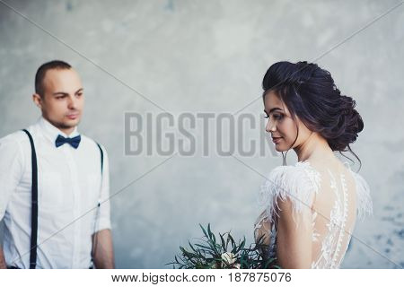 Newlyweds indoors together. Focus on the bride