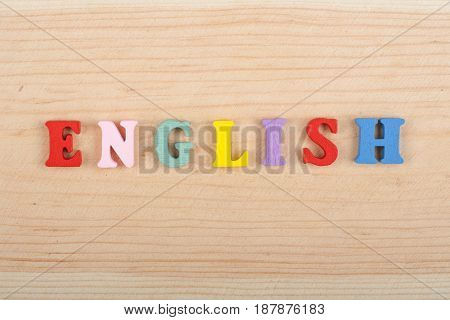 English word on wooden background composed from colorful abc alphabet block wooden letters, copy space for ad text. Learning english concept