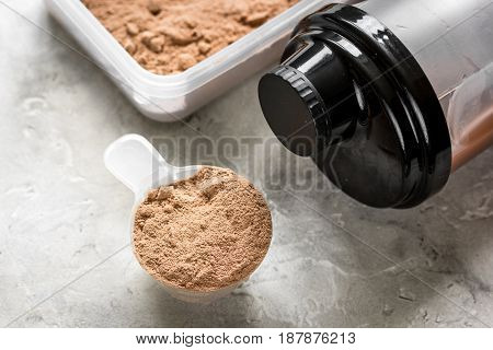 Fitness nutrition with shaker on stone table background