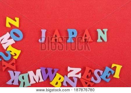 JAPANESE word on red background composed from colorful abc alphabet block wooden letters, copy space for ad text. Learning english concept
