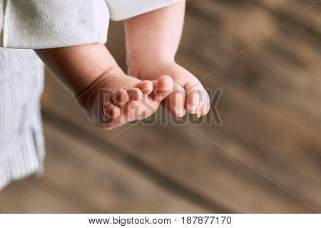 Feet of baby close up. Childish legs on blurred background. Things to know about newborns.