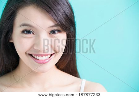 beauty woman with tooth whiten concept on green background