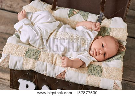 Little child lying on blanket. Adorable caucasian kid. How fast do babies grow.