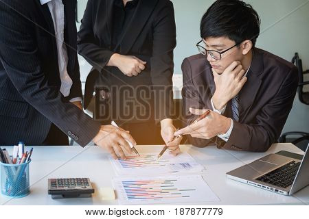 businessteam looking at report and having a discussion in office. business concept.