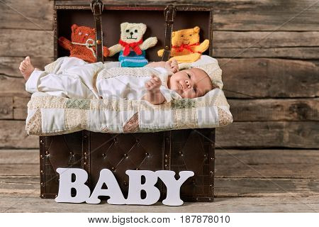 Opened suitcase and baby. Cute caucasian infant. How to raise kids.